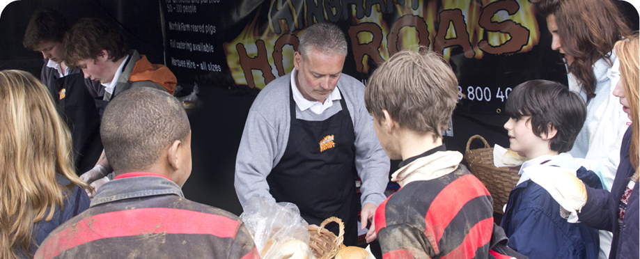 Hingham Hog Roast staff serving